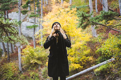 Young woman in autumn forest - p1427m2169347 by Oleksii Karamanov
