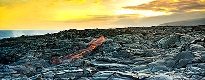 Fresh lava on rocks at sunset - p343m1485364 by Sean Davey