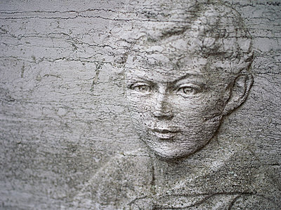Relief sculpture of boy on tombstone - p945m1462552 by aurelia frey