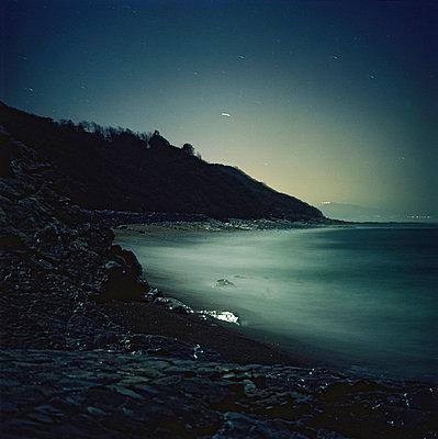 Beach in the night - p567m720735 by Sandrine Agosti Navarri