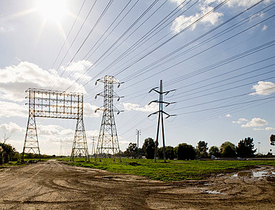Group of electricity pylons - p30118755f by Michael Wells