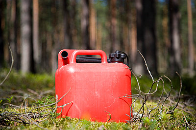 A red petrol can - p4263173f by Tuomas Marttila