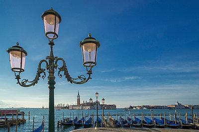 Gondolas and the Island of San Giorgio Maggiore, from St Mark's Square, Venice, Veneto, Italy - p429m954526f by Lost Horizon Images