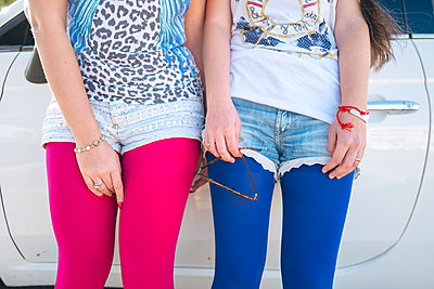 Young women wearing colourful tights - p1165m1222161 by Pierro Luca