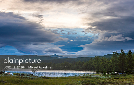 Lake with Helagsfjallet Mountain in the background in Harjedalen, Sweden - p352m2120264 by Mikael Ackelman