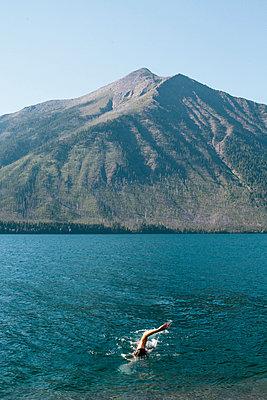 Man Swimming in Mountain Lake - p694m2068446 by Joyelle West