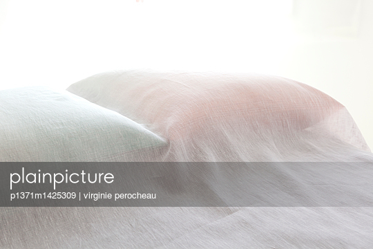 Pillow under bed sheets - p1371m1425309 by virginie perocheau