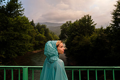 Portrait of a young woman in a raincoat - p1363m2063261 by Valery Skurydin
