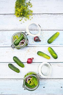 Preserving jars of gherkins and cucumbers - p300m1166132 by Larissa Veronesi