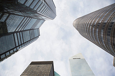 Low angle view of skyscrapers - p924m768371f by Ditto