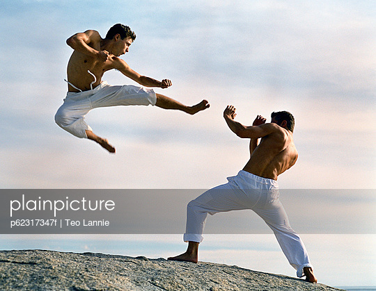Two men practicing martial arts