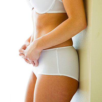 Woman wearing underwear - p4130052 by Tuomas Marttila