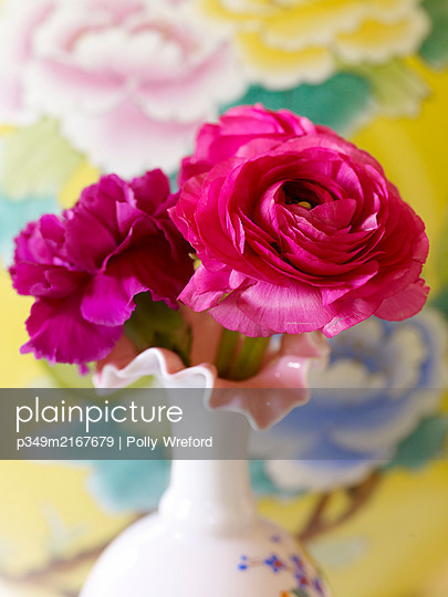 Bright pink flowers in vase - p349m2167679 by Polly Wreford