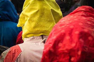 Rain on people wearing water-resistant clothes - p1418m1572203 by Jan Håkan Dahlström