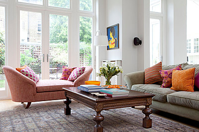 Pink double arm chaise with carved wooden coffee table - p349m740831 by Robert Sanderson