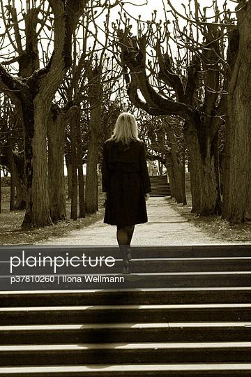 Woman walking up steps - p37810260 by Ilona Wellmann