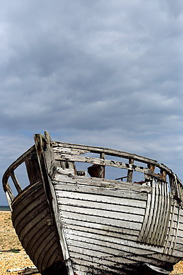 Vintage wooden boat on the beach - p1063m1134981 by Ekaterina Vasilyeva