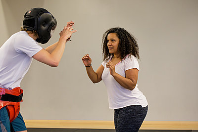 Woman training for self defense - p445m1503887 by Marie Docher