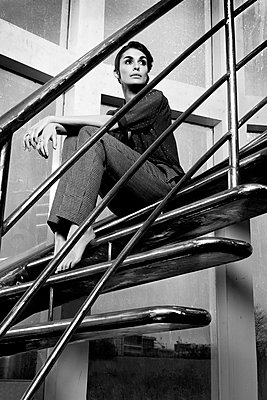 Woman on stairs - p548m912229 by Fred Leveugle