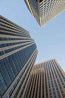 Low angle view of sky scrapers - p9246219f by Image Source