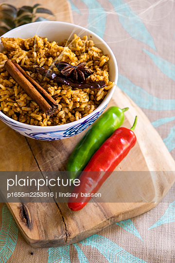 Flavoured rice in a bowl - p1655m2253516 by lindsay basson