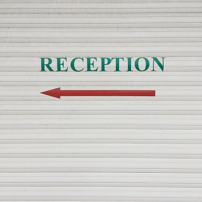Reception, directional arrow on wall - p1401m2260481 by Jens Goldbeck