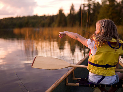 Lake of the Woods, Ontario, Canada; girl in a canoe - p4428607f by Design Pics