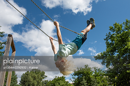 Boy on a swing - p1354m2292932 by Kaiser