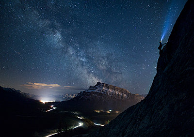 Climber under Milky Way, Banff National Park - p1424m1579531 by Paul Zizka