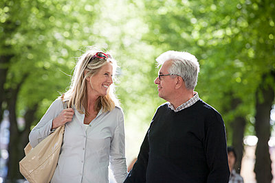 Mature couple walking in park - p312m1471454 by Lena Oritsland