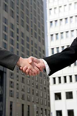 Two businesspeople shaking hands - p3011511f by fStop