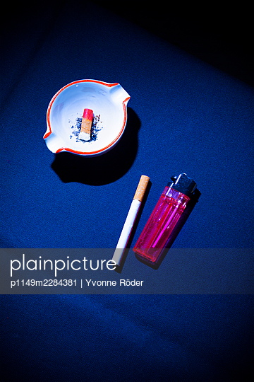 Cigarettes and lighter - p1149m2284381 by Yvonne Röder
