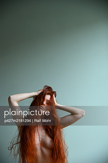 Nude with long red hair in a sexy pose - p427m2181294 by Ralf Mohr