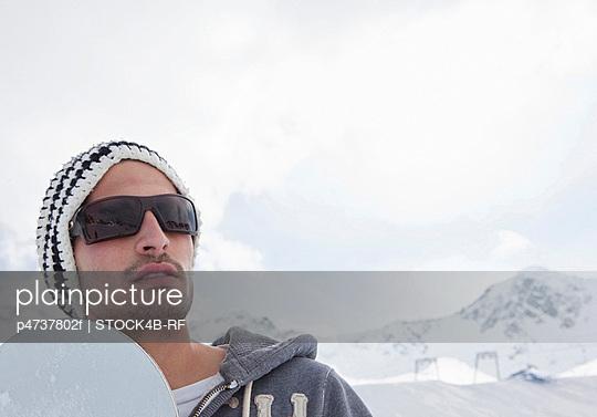 Snowboarder in winter landscape