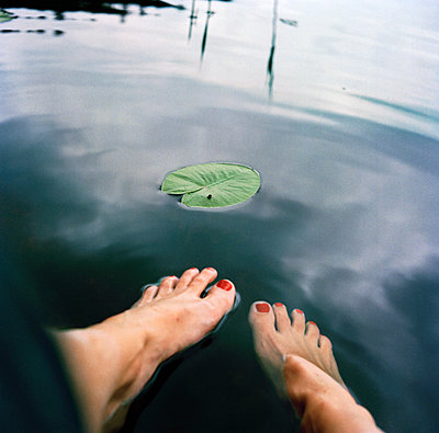 Womans feet in water - p312m2237404 by Pernille Tofte