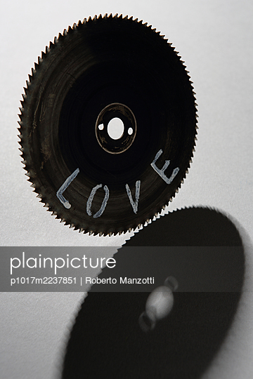 Circular saw blade with the inscription love - p1017m2237851 by Roberto Manzotti