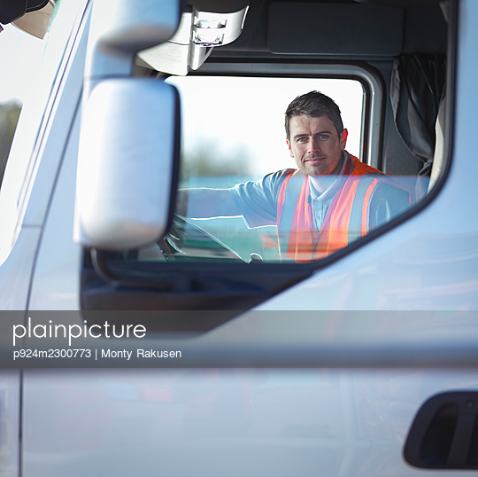 UK, Portrait of smiling truck driver - p924m2300773 by Monty Rakusen
