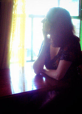 Profile of Beautiful Woman Gazing out Window - p1072m857322f by Michelle Kelly