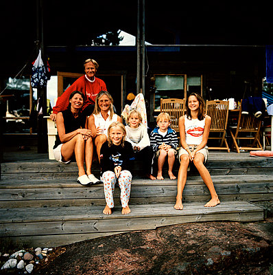 A family with friends sitting in front of a house Sweden. - p5281149 by Malcolm Hanes
