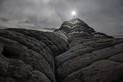 Low angle view of person holding illuminated torch while standing on Vermilion Cliffs - p1166m1193917 by Cavan Images