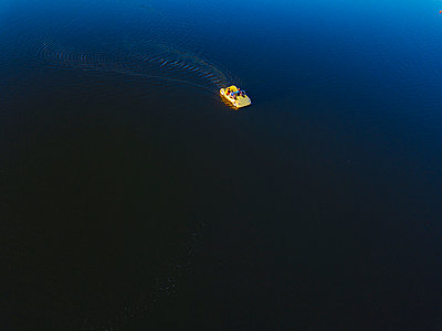 Yellow pedal boat on the water, drone photography - p1108m2210623 by trubavin