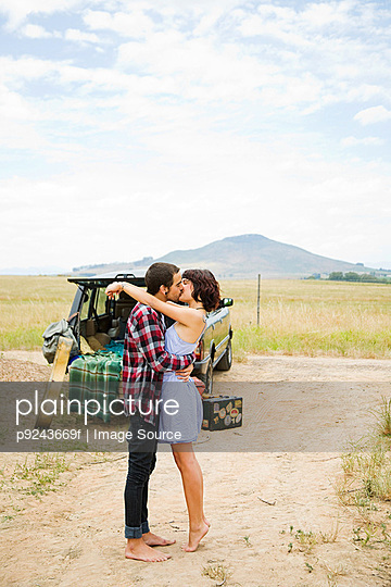 Young couple kissing outdoors