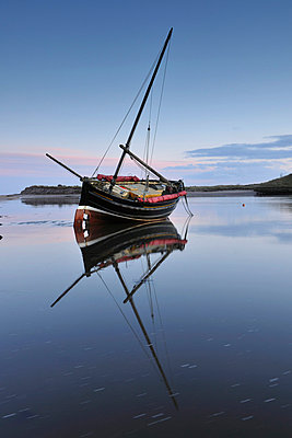 Old ketch reflecting in Aln Estuary as tide rises, Alnmouth, Northumberland, England, United Kingdom, Europe - p8710557 by Lee Frost