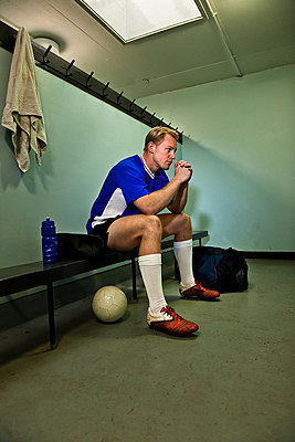 Soccer player in changing room - p92411402 by Rivers Dale