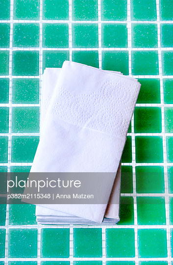Stack of handkerchiefs in the bathroom - p382m2115348 by Anna Matzen