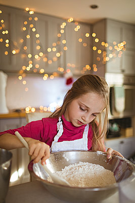 Girl preparing the dough for Christmas cookies - p1315m2041435 by Wavebreak