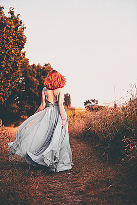 Woman wearing evening gown - p1695m2290922 by Dusica Paripovic