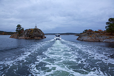 Motorboat on sea - p312m2092077 by Malcolm Hanes