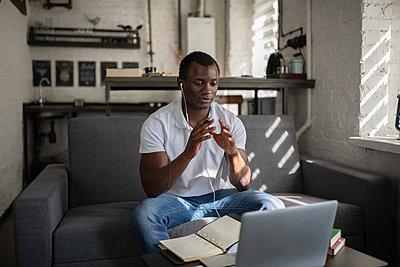 Black student talking with teacher online - p1166m2234980 by Cavan Images