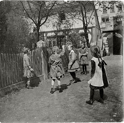 Group of girls playing together - p1541m2116866 by Ruth Botzenhardt